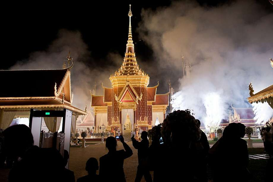 Fireworks are lit at the crematorium to mark the beginning of the cremation where a coffin bearing the remains of Cambodia's late King Norodom Sihanouk is placed, near the Royal Palace in Phnom Penh on February 4, 2013. Thousands of mourners massed in the Cambodian capital as the kingdom cremated its revered former King Norodom Sihanouk, who steered his country through six turbulent decades. Photo: Nicolas Asfouri, AFP/Getty Images
