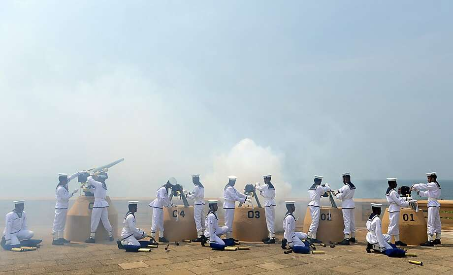 Sri Lankan Navy personnel fire a 21-gun salute on the capital's seafront Galle Face promenade to mark the island nation's 65th Independence Day in Colombo on February 4, 2013. Sri Lanka marked its freedom anniversary with a thinly veiled denunciation of Western moves to pass a new resolution against the island at the UN Human Rights Council. Photo: Ishara S.kodikara, AFP/Getty Images