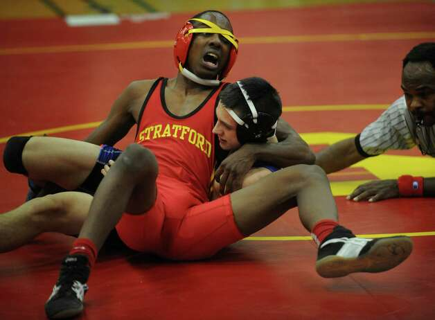 Stratford's Mike Butler defeats rival Bunnell's Dante Gierula in a close match in the 126 pound class during their wrestling meet at Stratford High School on Monday, February 4, 2013. Photo: Brian A. Pounds