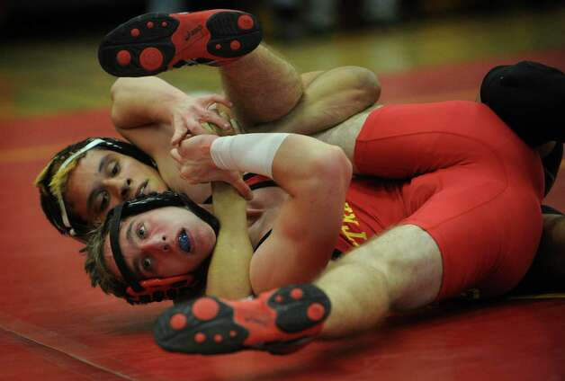 Bunnell's Christian Perez, top, defeats rival Stratford's Brian Evan in the 132 pound class during their wrestling meet at Stratford High School on Monday, February 4, 2013. Photo: Brian A. Pounds