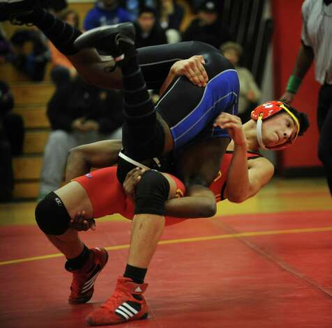 Stratford's Dariell Diaz takes down rival Bunnell's Ben Nwaohuecha in the 160 pound class during their wrestling meet at Stratford High School on Monday, February 4, 2013. Photo: Brian A. Pounds