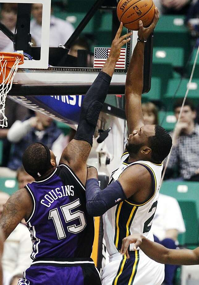 Utah's Al Jefferson shoots over Sacramento's DeMarcus Cousins, who was ejected at halftime. Photo: Rick Bowmer, Associated Press