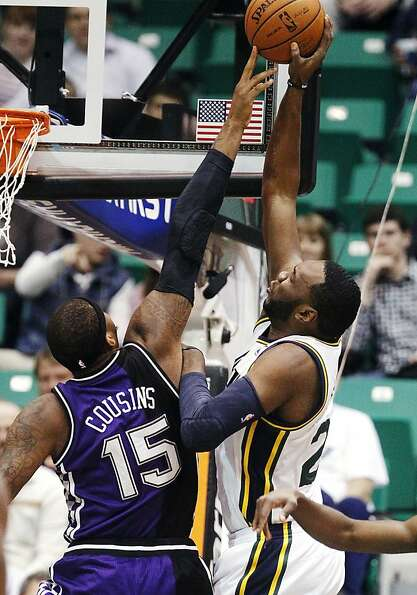 Utah's Al Jefferson shoots over Sacramento's DeMarcus Cousins, who was ejected at halftime.