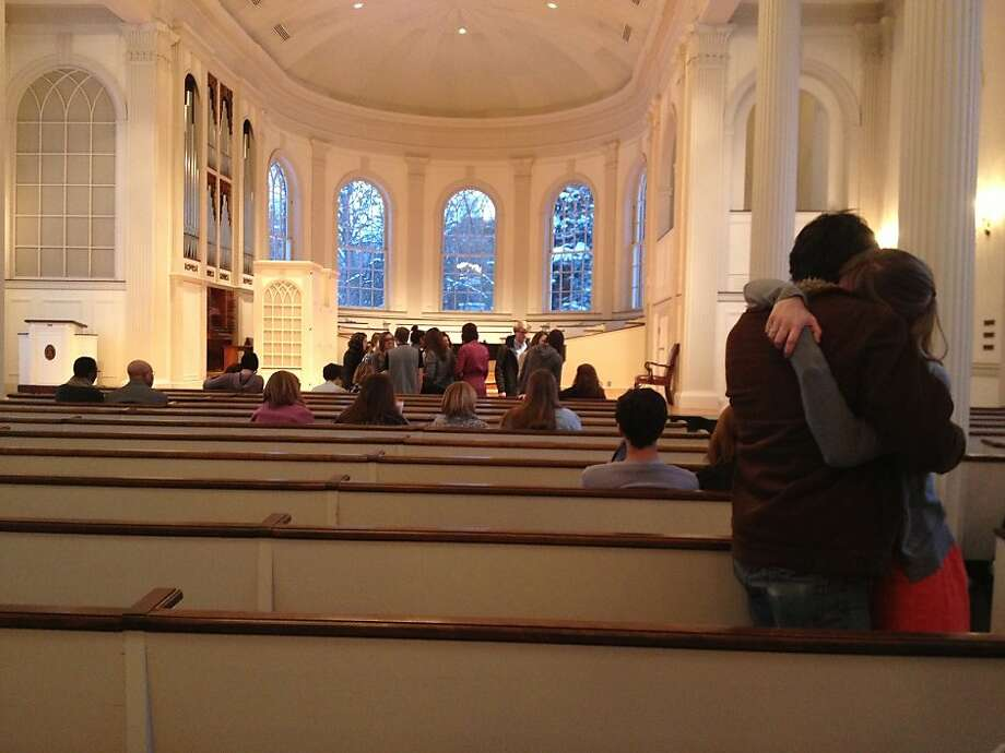 In this photo taken Sunday, Feb. 3, 2013, mourners embrace as others gathered at Kalamazoo College's Stetson Chapel in Kalamazoo, Mich., to remember Emily Stillman, 19, a sophomore who died that morning due to complications from bacterial meningitis. Photo: Emily Monacelli, Associated Press