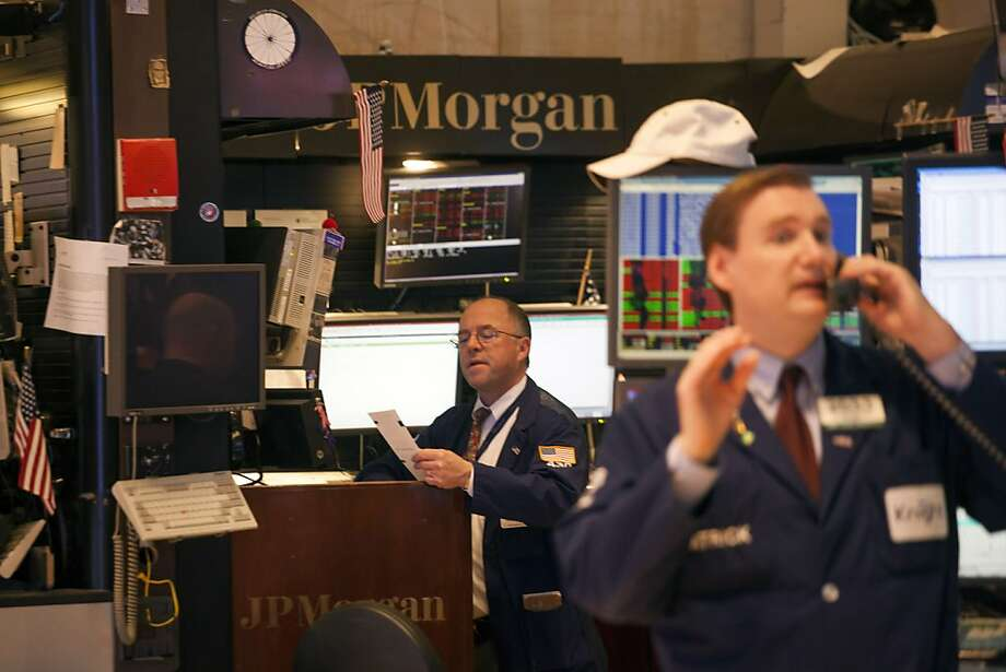 Traders work on the floor of the New York Stock Exchange on February 4, 2013 in New York City. Stocks dropped sharply today following the Dow's close last week above 14000. Photo: Michael Nagle, Getty Images