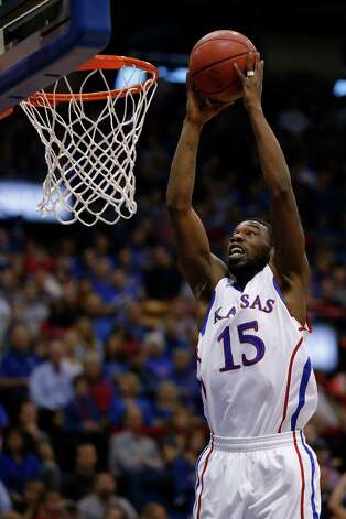 Not: Kansas G Elijah Johnson — The senior point guard clanked through at 3-for-14 shooting night with four turnovers against Oklahoma State. Johnson is shooting 12-for-47 from the field (25.5 percent) with 19 turnovers and 19 assists over last five games.    (AP Photo/Orlin Wagner) Photo: Orlin Wagner, Associated Press / AP