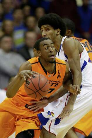 Hot: Oklahoma State G Markel Brown — Singed Kansas for a season-best 28 points — his third 20-plus scoring game in his last five. Brown hit seven 3-pointers against the Jayhawks and is 12-for-19 behind the arc in his last three games.   (AP Photo/Orlin Wagner) Photo: Orlin Wagner, Associated Press / AP