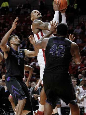 Not:  Oklahoma — The Sooners were limited to eight assists in their loss to Kansas State. It marked their lowest since notching six in their loss to Stephen F. Austin on Dec. 28.    (AP Photo/Alonzo Adams) Photo: Alonzo Adams, Associated Press / FR159426 AP