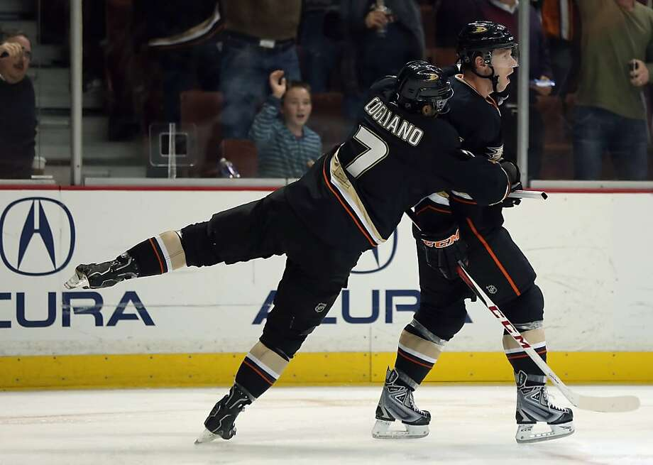 Andrew Cogliano (7) congratulates Saku Koivu after his game-tying third-period goal. Photo: Jeff Gross, Getty Images