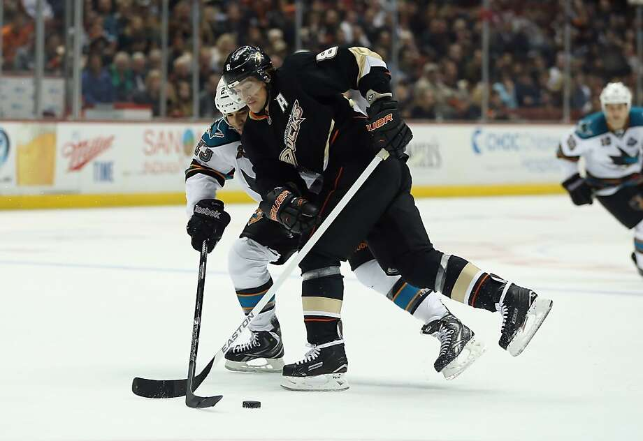 ANAHEIM, CA - FEBRUARY 04:  Teemu Selanne #8 of the Anaheim Ducks and Scott Gomez #23 of the San Jose Sharks battle for the puck in the second period at Honda Center on February 4, 2013 in Anaheim, California.  (Photo by Jeff Gross/Getty Images) Photo: Jeff Gross, Getty Images