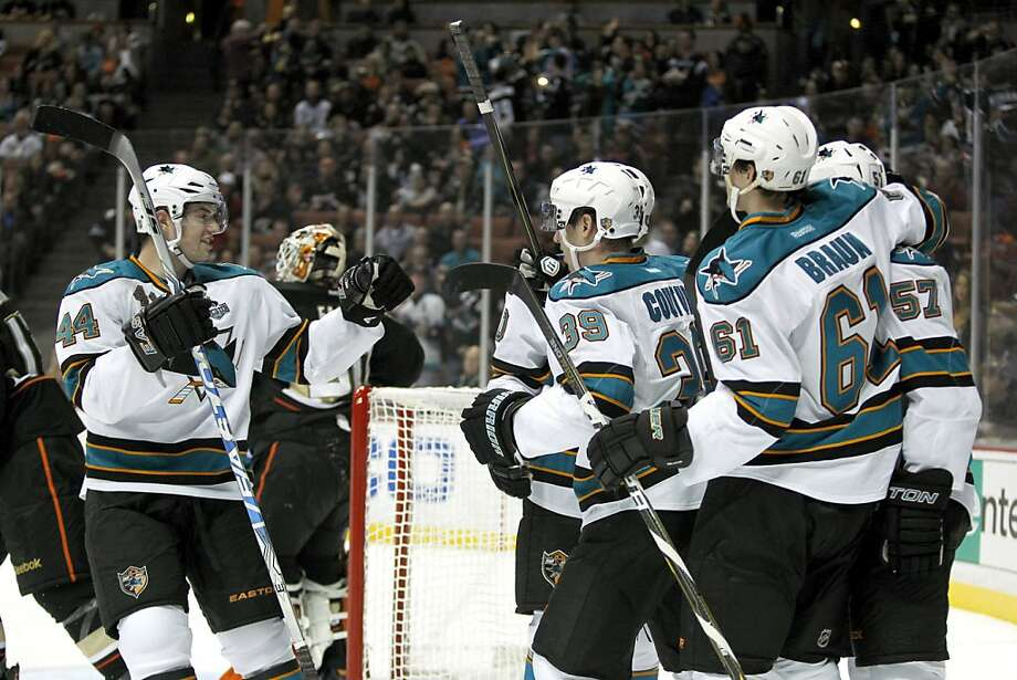 San Jose Sharks defenseman Marc-Edouard Vlasic (44) celebrates a goal by center Logan Couture (39) with defenseman Justin Braun (61) and center Tommy Wingels (57) against the Anaheim Ducks during the first period of their NHL hockey game, Monday, Feb. 4, 2013, in Anaheim, Calif.  (AP Photo/Alex Gallardo) Photo: Alex Gallardo, Associated Press