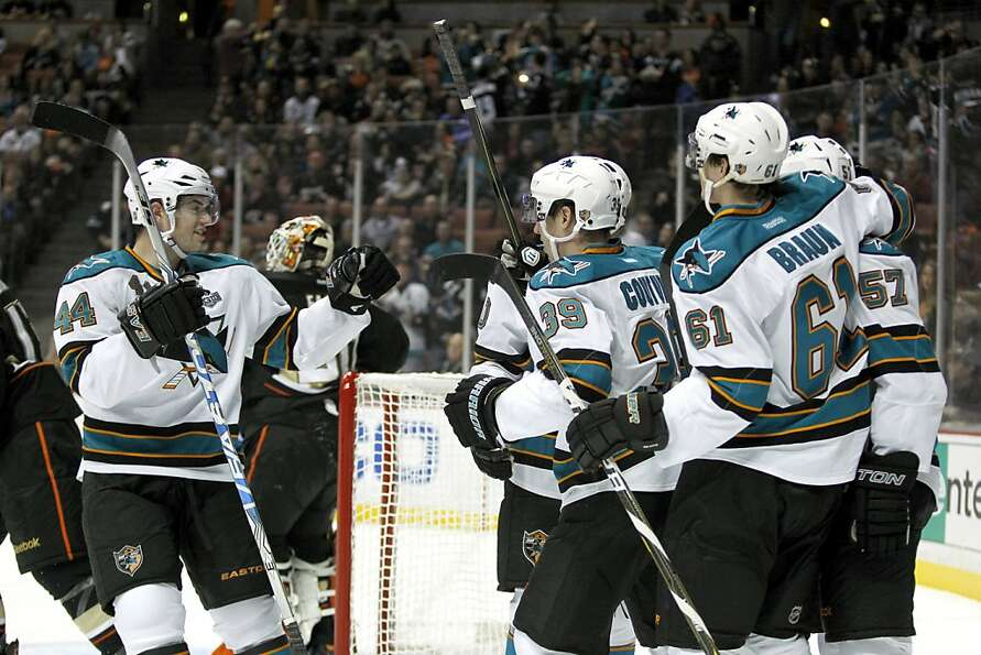 San Jose Sharks defenseman Marc-Edouard Vlasic (44) celebrates a goal by center Logan Couture (39) w