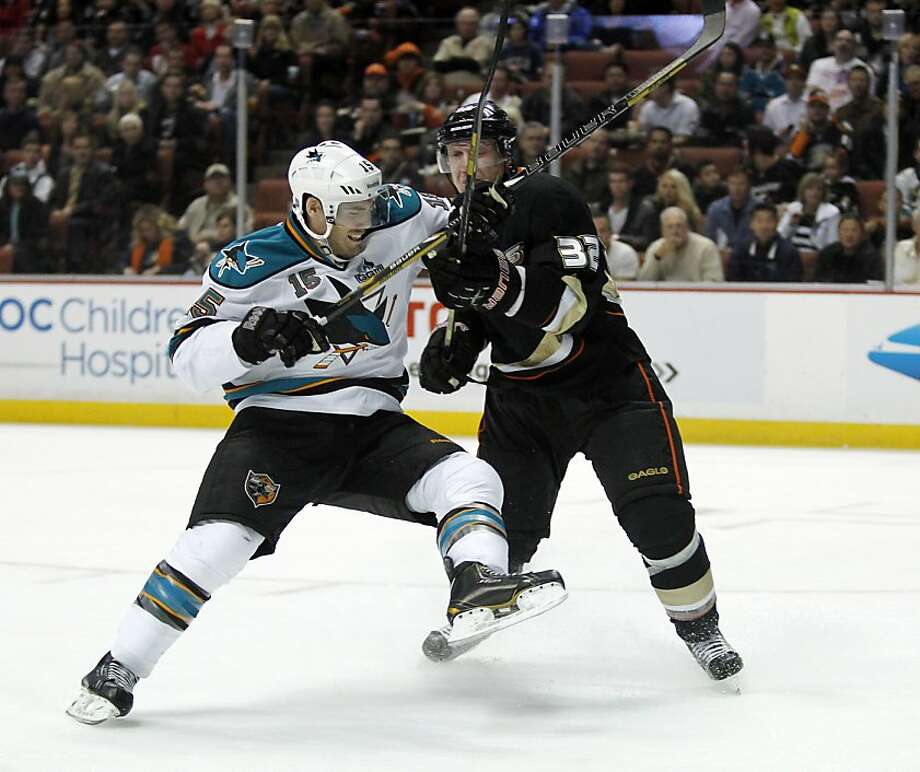 San Jose Sharks center James Sheppard (15) collides with Anaheim Ducks defenseman Toni Lydman (32), of Finland, during the first period of their NHL hockey game, Monday, Feb. 4, 2013, in Anaheim, Calif. (AP Photo/Alex Gallardo) Photo: Alex Gallardo, Associated Press