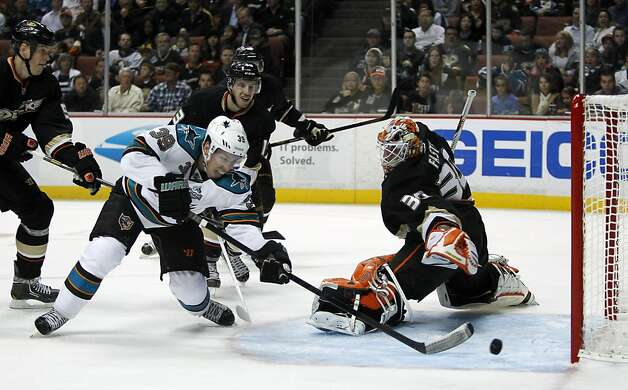 San Jose Sharks center Logan Couture (39) scores a goal against Anaheim Ducks goalie Viktor Fasth (30), of Sweden, with Ducks defenseman Bryan Allen, left and Ducks center Nick Bonino, behind Couture, defending during the first period of their NHL hockey game, Monday, Feb. 4, 2013, in Anaheim, Calif.  (AP Photo/Alex Gallardo) Photo: Alex Gallardo, Associated Press