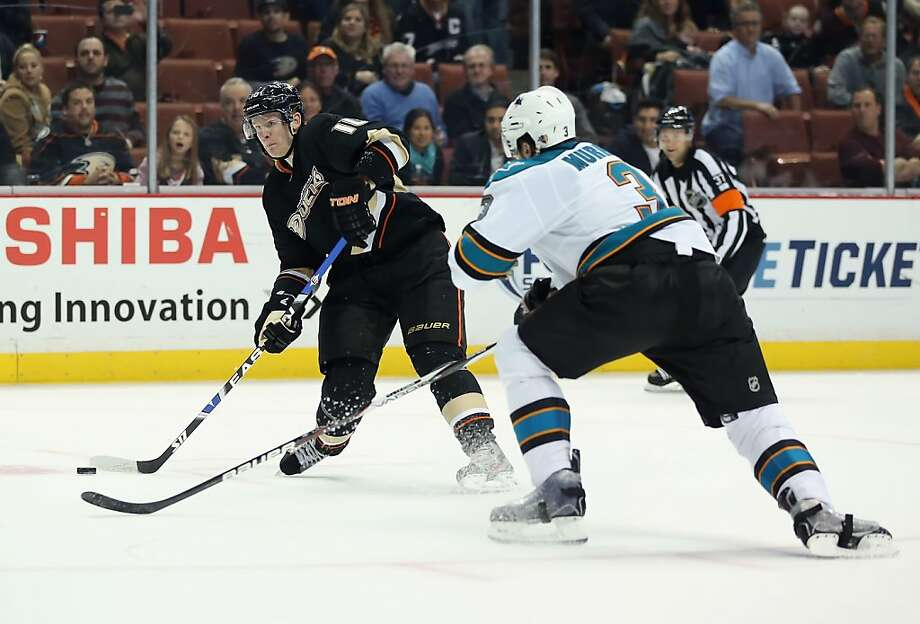 ANAHEIM, CA - FEBRUARY 04:  Corey Perry #10 of the Anaheim Ducks shoots the puck past Douglas Murray #3 of the San Jose Sharks in the third period at Honda Center on February 4, 2013 in Anaheim, California. The Ducks defeated the Sharks 2-1.  (Photo by Jeff Gross/Getty Images) Photo: Jeff Gross, Getty Images
