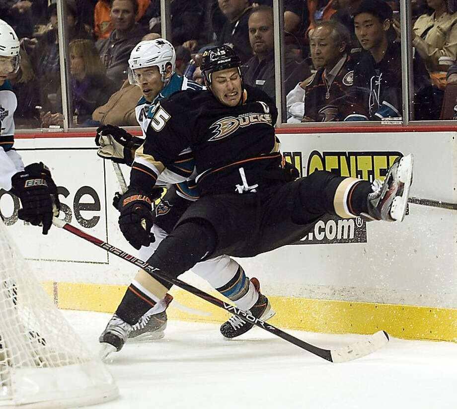 Anaheim Ducks' Ryan Getzlaf is checked by San Jose Sharks' Joe Pavleski during the first period in Anaheim, California, Monday, February 4, 2013. (Rose Palmisano/Orange County Register.MCT) Photo: Rose Palmisano,, McClatchy-Tribune News Service