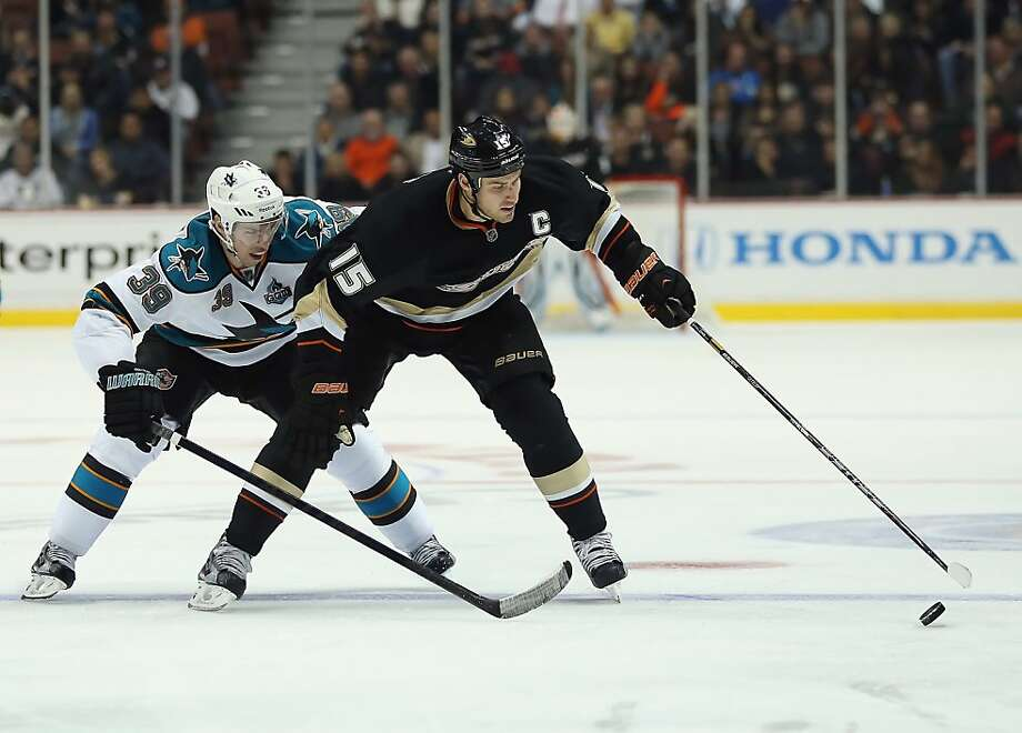 ANAHEIM, CA - FEBRUARY 04:  Ryan Getzlaf #15 of the Anaheim Ducks is pursued by Logan Couture #39 of the San Jose Sharks for the puck in the third period at Honda Center on February 4, 2013 in Anaheim, California. The Ducks defeated the Sharks 2-1.  (Photo by Jeff Gross/Getty Images) Photo: Jeff Gross, Getty Images