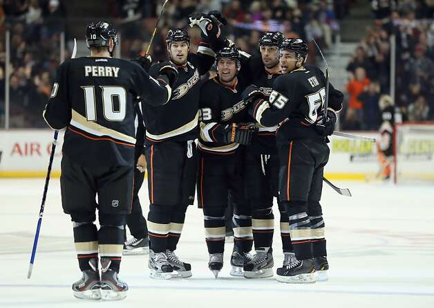 ANAHEIM, CA - FEBRUARY 04:  (L-R) Corey Perry #10, Ryan Getzlaf #15, Francois Beauchemin #23, Sheldon Souray #44 and Emerson Etem #65 of the Anaheim Ducks celebrate Souray's third period goal against the San Jose Sharks at Honda Center on February 4, 2013 in Anaheim, California. The Ducks defeated the Sharks 2-1.  (Photo by Jeff Gross/Getty Images) Photo: Jeff Gross, Getty Images