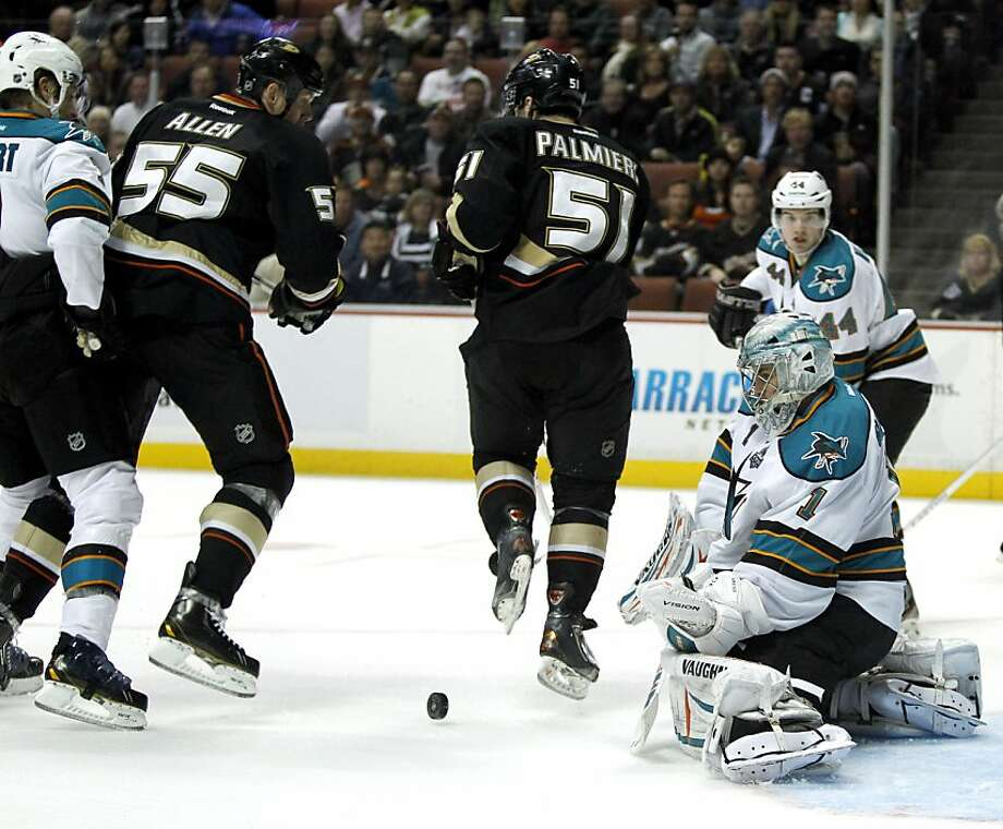 San Jose Sharks goalie Thomas Greiss (1), of Germany, stops a shot on goal with Anaheim Ducks defenseman Bryan Allen (55) and Anaheim Ducks right wing Kyle Palmieri (51) on the attack with Sharks defenseman Brad Stuart, left, and Sharks defenseman Marc-Edouard Vlasic (44) defending during the second period of their NHL hockey game, Monday, Feb. 4, 2013, in Anaheim, Calif.  (AP Photo/Alex Gallardo) Photo: Alex Gallardo, Associated Press