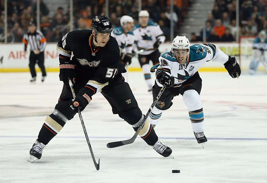 ANAHEIM, CA - FEBRUARY 04:  Bryan Allen #55 of the Anaheim Ducks is pursued by James Sheppard #15 of the San Jose Sharks for the puck in the second period at Honda Center on February 4, 2013 in Anaheim, California.  (Photo by Jeff Gross/Getty Images) Photo: Jeff Gross, Getty Images