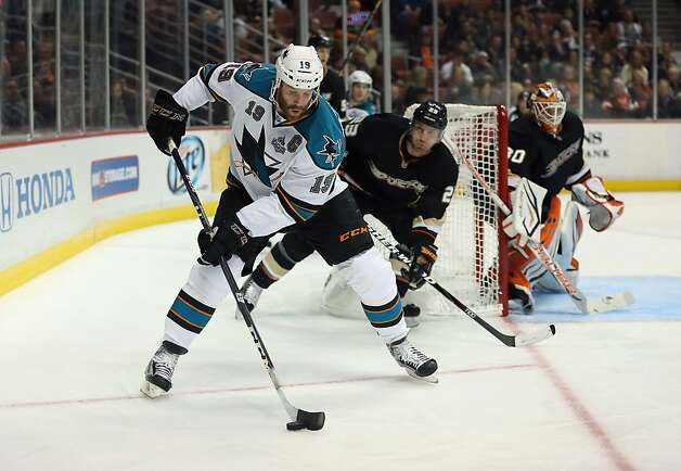 ANAHEIM, CA - FEBRUARY 04:  Joe Thornton #19 of the San Jose Sharks is pursued by Francois Beauchemin #23 of the Anaheim Ducks for the puck in the second period at Honda Center on February 4, 2013 in Anaheim, California.  (Photo by Jeff Gross/Getty Images) Photo: Jeff Gross, Getty Images