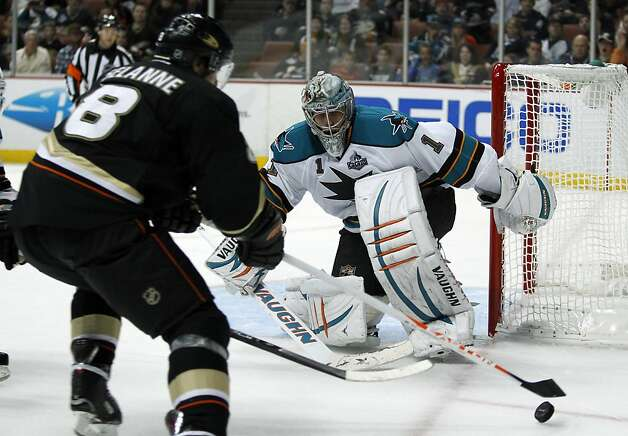 Anaheim Ducks right wing Teemu Selanne (8), of Finland, lines up the puck for a shot as San Jose Sharks goalie Thomas Greiss (1), of Germany, defends during the second period of their NHL hockey game, Monday, Feb. 4, 2013, in Anaheim, Calif.  (AP Photo/Alex Gallardo) Photo: Alex Gallardo, Associated Press