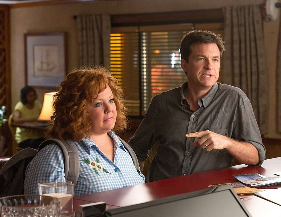"Melissa McCarthy cons Jason Bateman out of his identity - did we mention he plays a businessman named Sandy? - in ""Identity Thief."" Photo: Associated Press"