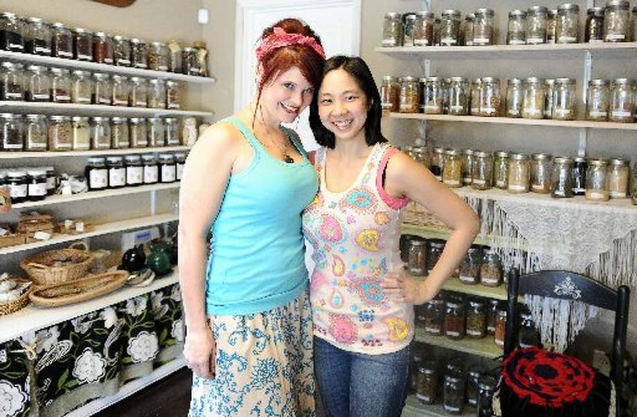 Owners of Down to Earth in Nederland, Alisha Ortego, left, and Vanlam Nguyen, right, sport their Posh & Company attire. Posh & Company is a dealer of Down to Earth products such as organic and locally sourced candles, soaps, tea blends, and other health and wellness-type items. Randy Edwards/cat5