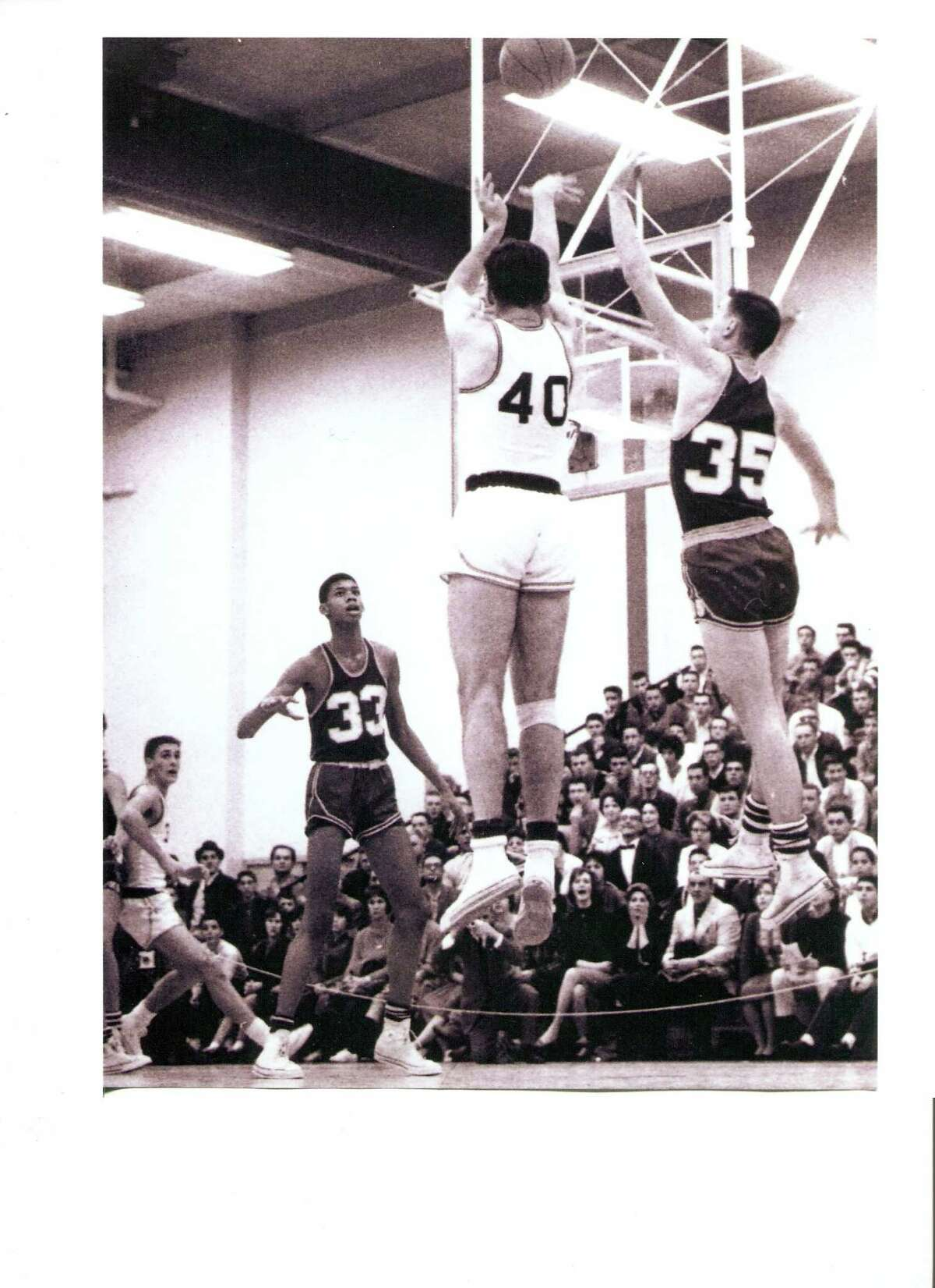 No. 33 Lew Alcindor and Pat Riley, boxing out at left, at the 1961 meeting of the 2 NBA Hall of Famers in Schenectady, N.Y. The home team beat Power Memorial 74-68. Bob DeLuca No. 40 and and Riley both scored 19 for the Linton High School squad that held Lew, later Kareem Abdul-Jabbar, to 8 points. Read more about it in Marv Cermak's column. (Photo courtesy of Bob Pezzanno)