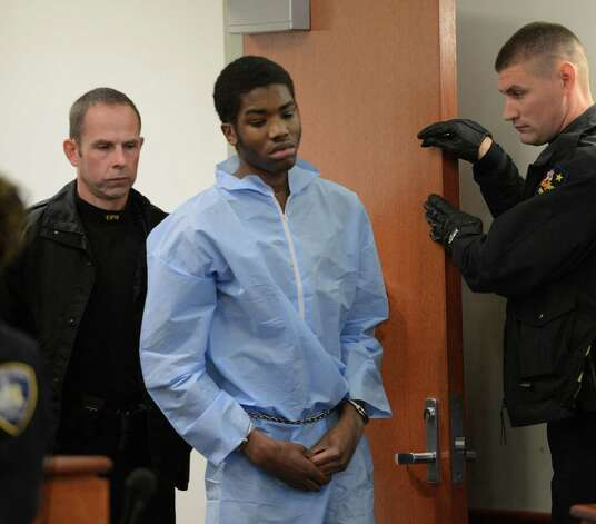 Keith Ferguson, 17, of Troy is brought into Troy City Court on Tuesday morning, Feb. 5, 2013, in Troy, N.Y., for his arraignment in connection with the death of of Takim Smith. (Skip Dickstein/Times Union) Photo: SKIP DICKSTEIN