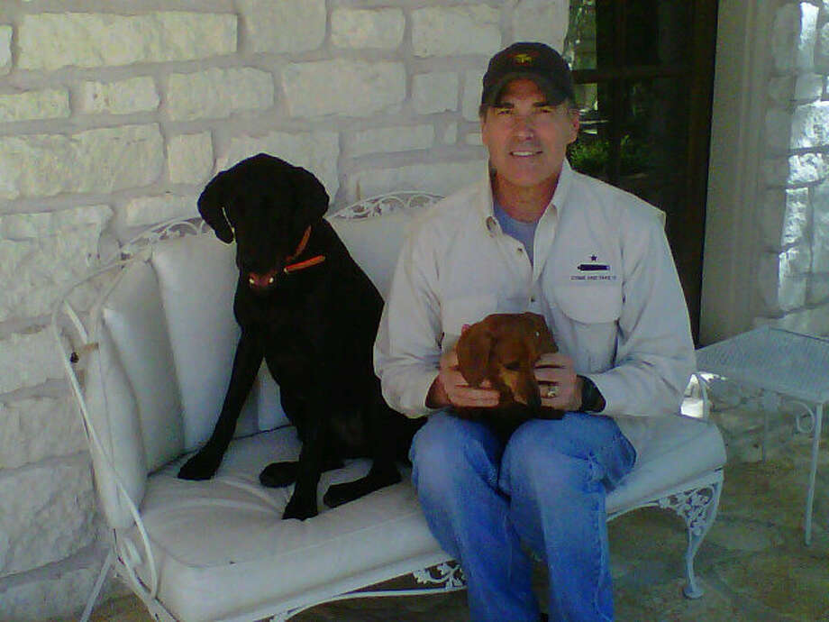 Perry with Rory (the black lab) and Lucy (the wiener dog.)