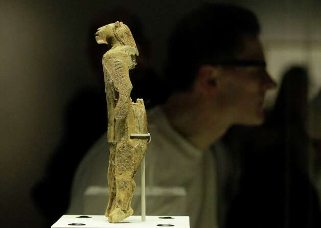 A mammoth ivory sculpture depicts a man with a lion's head, discovered at Stadel Cave, Baden-Wurttemberg, Germany, dates to around 40,000 years ago is seen on display in an exhibition 'Ice Age Art : arrival of the modern mind' at the British Museum in London, Tuesday, Feb. 5, 2013. The exhibition present masterpieces create from the last Ice Age between 40,000 and 10,000 years ago, drawn from across Europe, by artists with modern minds and presented alongside modern works  to illustrate the fundamental human desire to communicate and make art as a way of understanding ourselves and our place in the world. (AP Photo/Sang Tan) Photo: Sang Tan