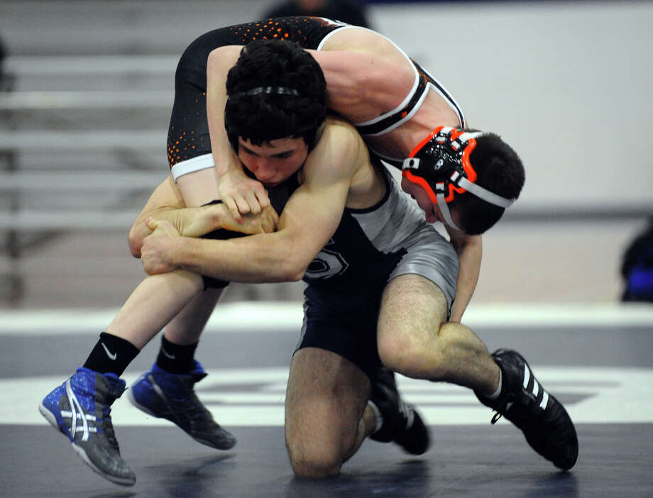Staples' Jeremy Sherman goes up against Ridgefield's Colin Storm, during wrestling action in Westport, Conn. on Wednesday January 9, 2013. Photo: Christian Abraham