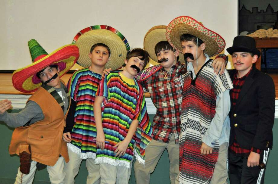 Middlesex Middle School seventh-grade students get into the spirit of Latin American Day. The students began the day portraying a Latin American character they had researched. Photo: Contributed