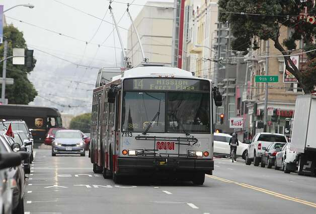 A 14 Mission line Muni bus drives in two lanes of traffic as it travels east bound on Mission Street on Monday, February 4, 2013 in San Francisco, Calif. Photo: Lea Suzuki, The Chronicle