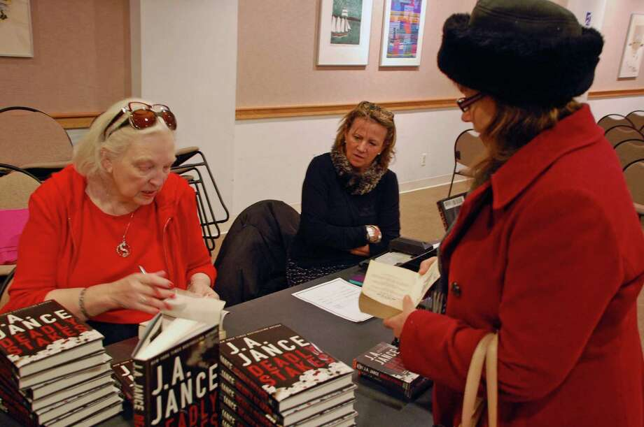 "Jarret Liotta/For the New Canaan News Lucretia Ryan of South Salem, N.Y., has a copy of ""Deadly Stakes"" signed by the author, J.A. Jance., at the New Canaan Library on Monday, Feb. 4. ""I'm a big fan,"" said Ryan. Photo: Contributed"