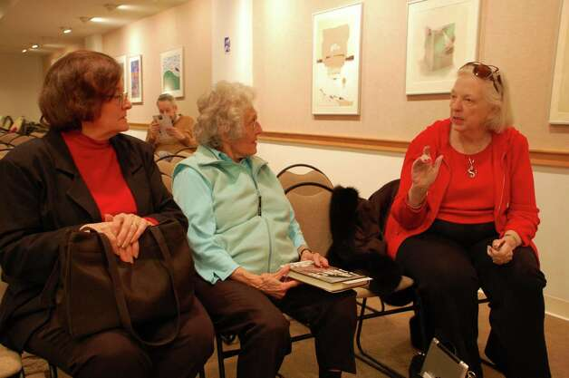 "Author J.A. Jance, right, chats with fans Judy Cyr Cody, left, and her mother, Elsie Cyr, center. Jance gave a talk at the New Canaan  Library on Monday, Feb. 4, to publicize release other latest novel ""Deadly Stakes."" Photo: Contributed"