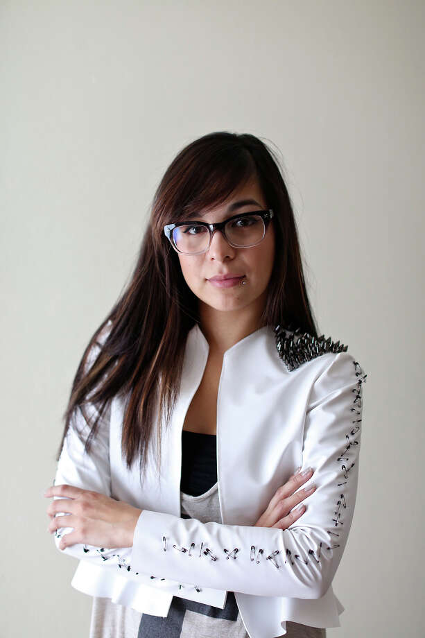 Designer Samantha Plasencia wears a jacket from her collection she'll be showing at Mercedes-Benz Fashion Week in New York. Photo: Lisa Krantz, San Antonio Express-News / © 2012 San Antonio Express-News