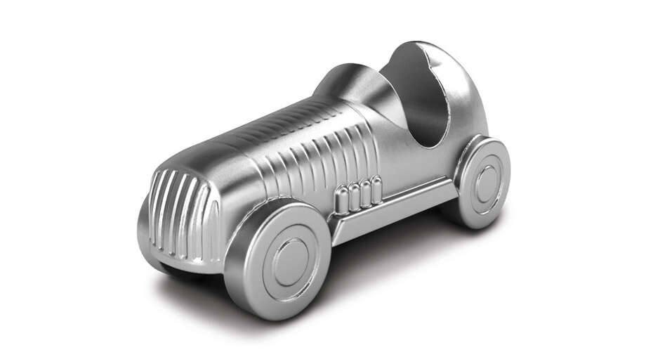 The car was originally modeled after a 1930s roadster. Designed as the vehicle of choice for Mr. MONOPOLY, the racecar has become the favorite of those who love the rush of adrenaline. Photo: Hasbro