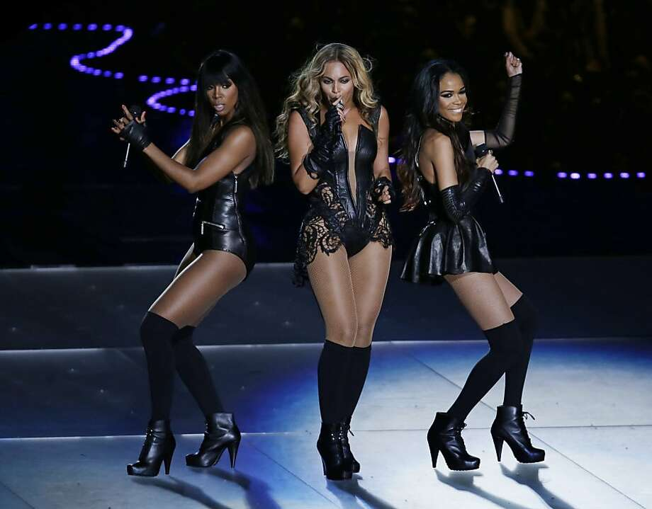Beyonce performs with Kelly Rowland, left, and Michelle Williams, right, of Destiny's Child, during the halftime show of the NFL Super Bowl XLVII football game between the San Francisco 49ers and the Baltimore Ravens, Sunday, Feb. 3, 2013, in New Orleans. (AP Photo/Gerald Herbert) Photo: Gerald Herbert, Associated Press