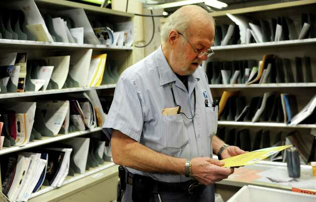 Letter Carrier Jerry Fortin works at the carrier annex in Stamford after he was recognized for having been a United States Postal Service employee for 50 years on Tuesday, February 5, 2013. Photo: Lindsay Perry / Stamford Advocate