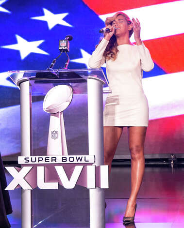 Beyonce speaks onstage at the Pepsi Super Bowl XLVII Halftime Show Press Conference at the Ernest N. Morial Convention Center. Beyonce will embark on a world tour that stops at Mohegan Sun Arena on Aug. 2. Photo: Christopher Polk, Getty Images / 2013 Getty Images