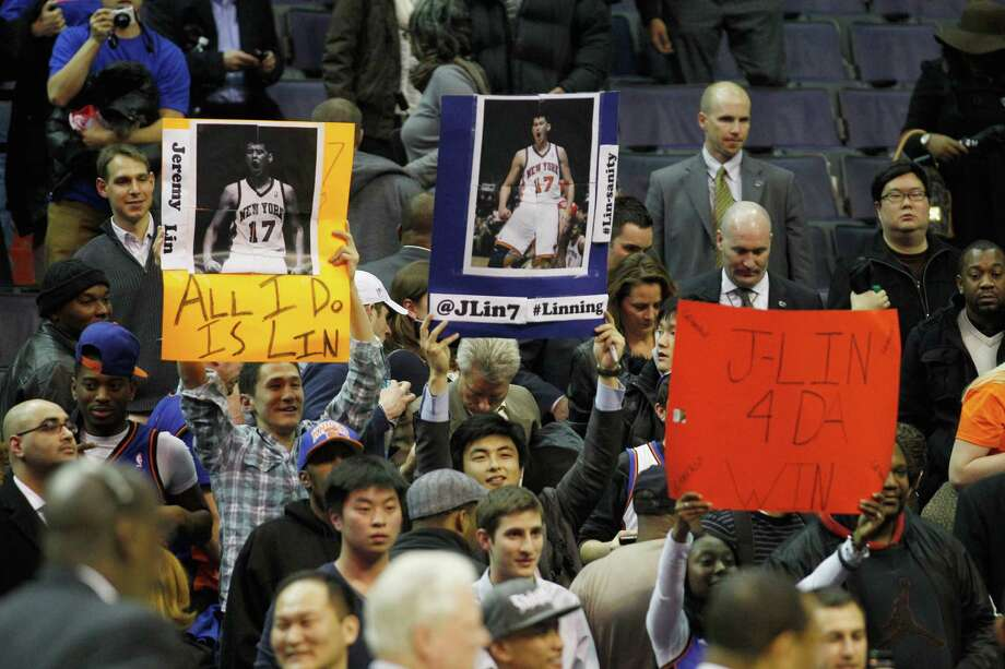 Fans of Jeremy Lin hold up signs. Photo: Rob Carr, Getty Images / 2012 Getty Images