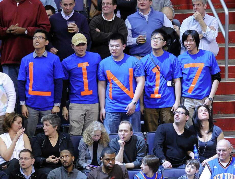 A group of fans show their support for New York Knicks point guard Jeremy Lin. Photo: CHUCK MYERS, McClatchy-Tribune News Service / MCT