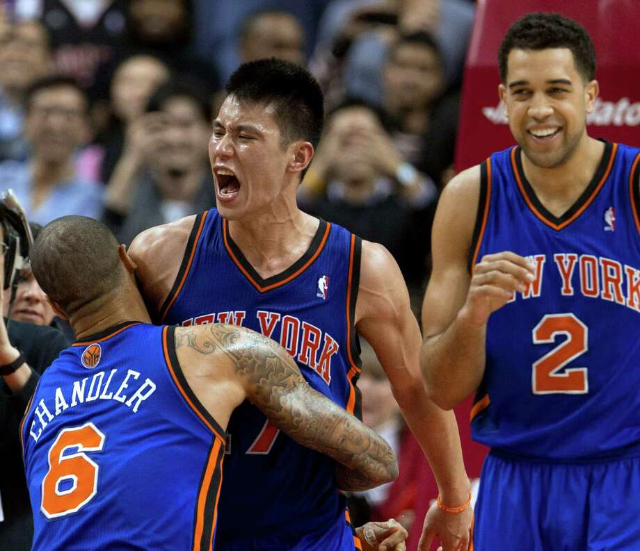 New York Knicks guard Jeremy Lin (17) celebrates with teammates Tyson Chandler and Landry Fields (2) after his game-winning 3-pointer against the Toronto Raptors on Tuesday. Photo: Frank Gunn, Associated Press / The Canadian Press