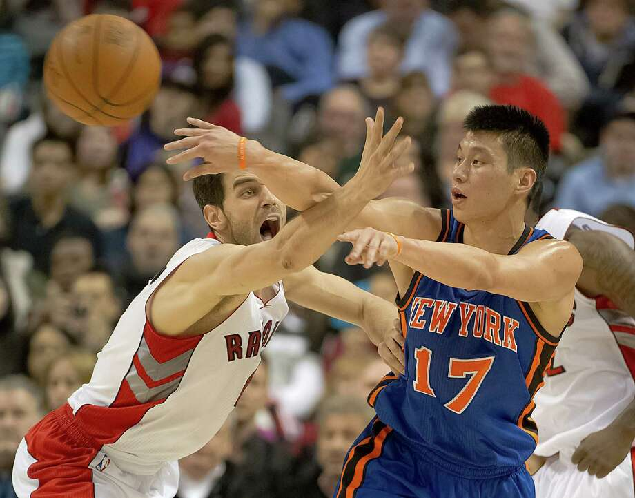 Toronto Raptors Jose Calderon, left,  defends against New York Knicks shooting guard Jeremy Lin, right. Photo: Peter J. Thompson, McClatchy-Tribune News Service / Postmedia News