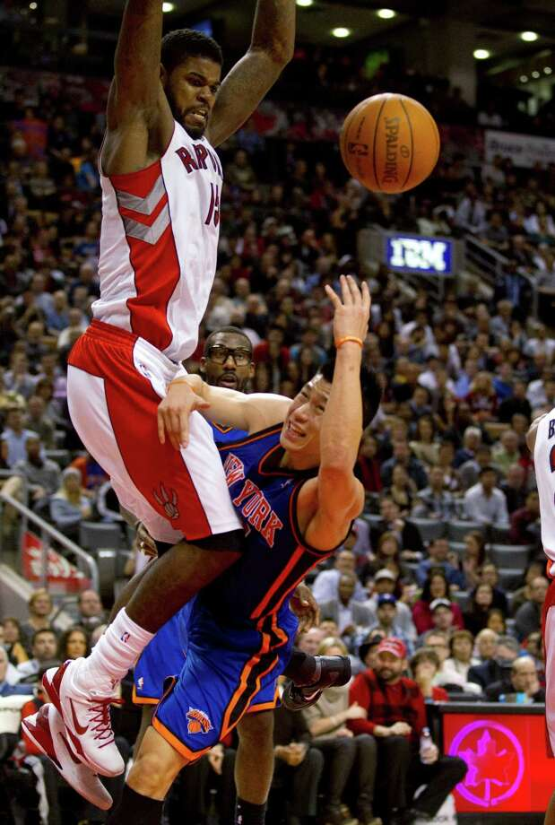 New York Knicks guard Jeremy Lin (17) gets hammered for a foul by Toronto Raptors forward Amir Johnson. Photo: Frank Gunn, Associated Press / CP