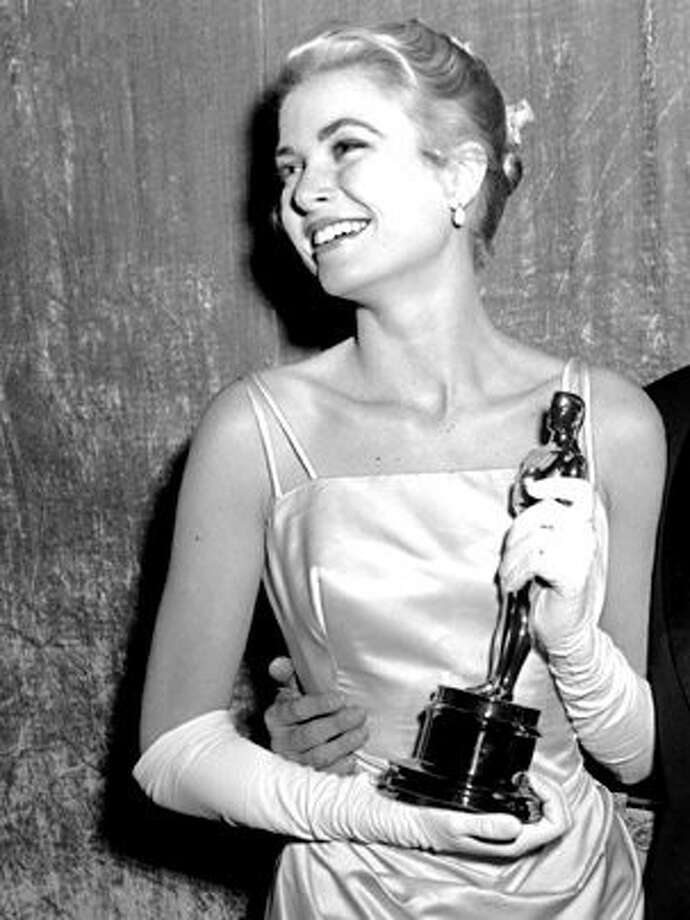 Grace Kelly with the Oscar she won in 1954 for The Country Girl.  I'm not sure she should have won for any of her performances, but least of all this one -- her worst.  She was at least decent and usually quite good in everything else.