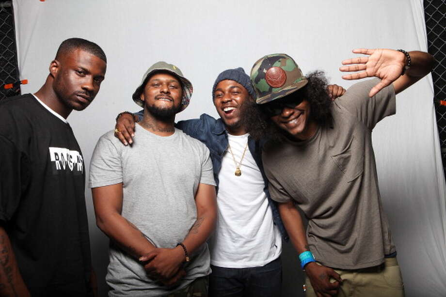 Schoolboy Q, second from left, and Ab-Soul, on right, pictured backstage at Fader Fort during SXSW on March 16, 2012 in Austin, Texas. Photo: Roger Kisby, Getty Images / 2012 Roger Kisby