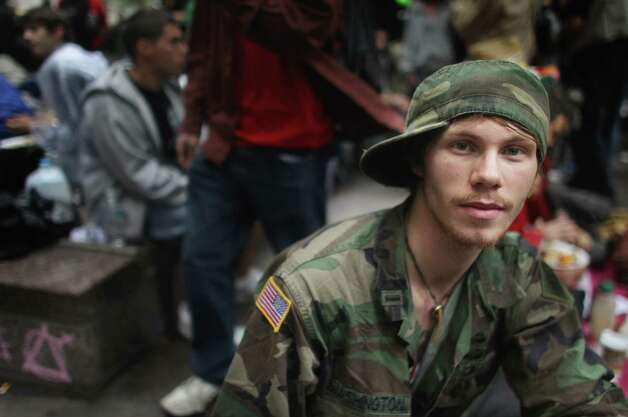 Peace, whose member Keane Kendall is pictured above at Zuccotti Park along with members of the Occupy Wall Street movement on Oct. 1, 2011 in New York City. Photo: Mario Tama, Getty Images / 2011 Getty Images